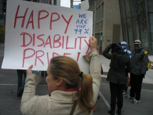 person carrying Happy Disability Pride! Sign