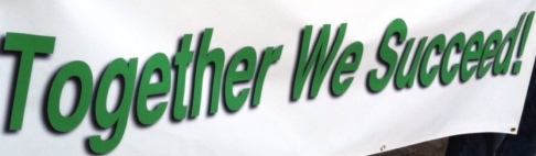 White banner with Together we Succeed! written in green